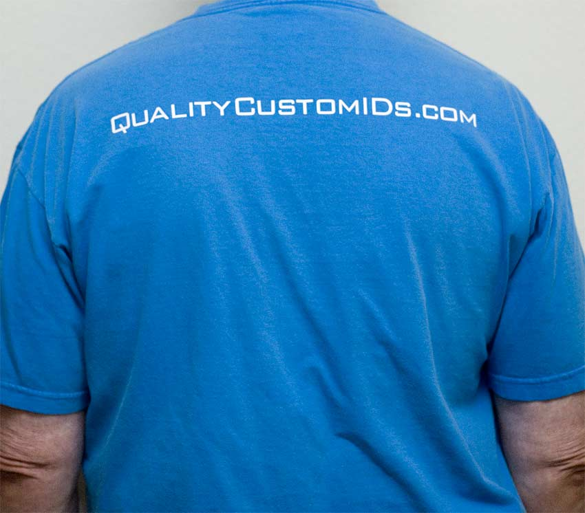 White Vinyl Logo on Blue Shirt